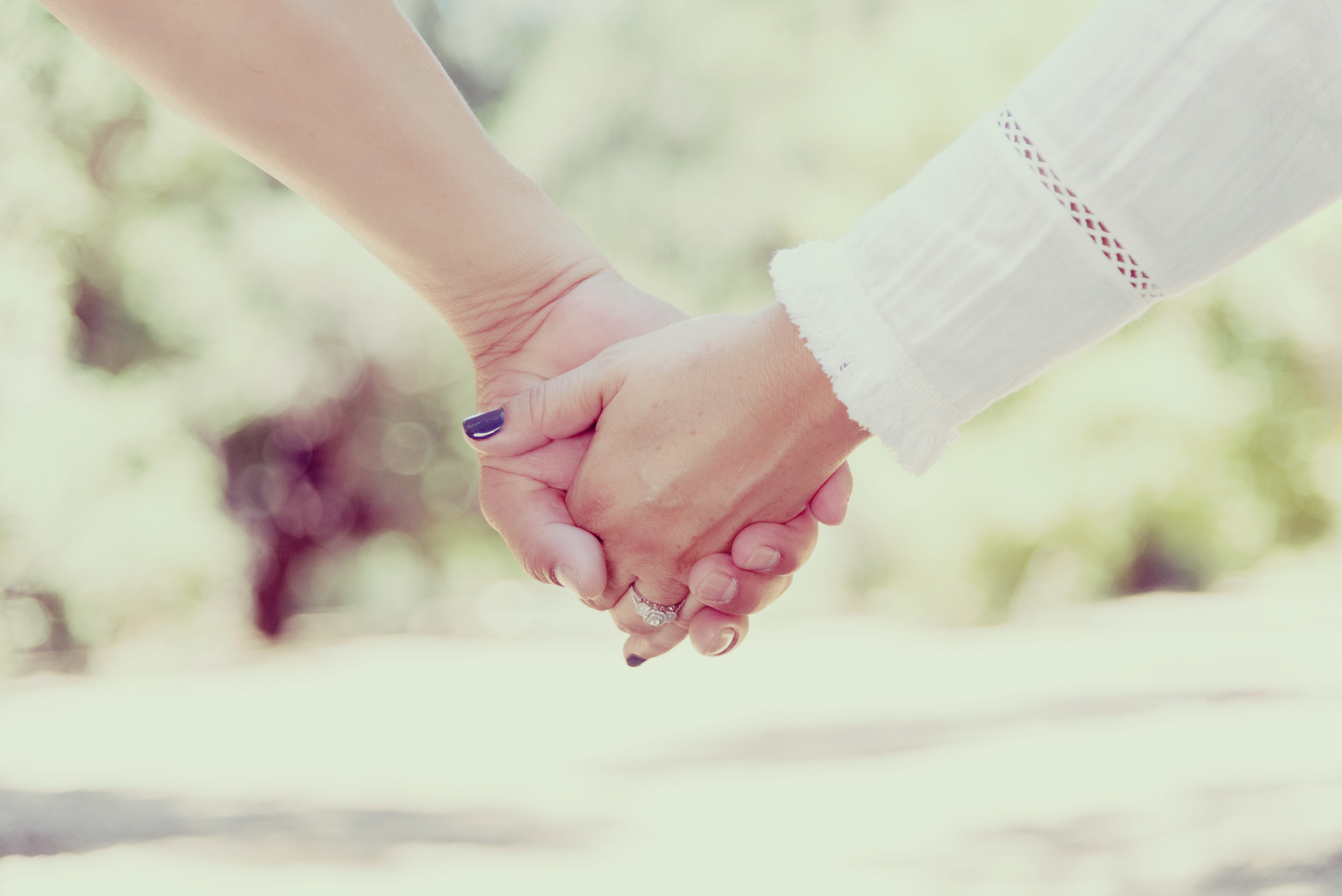 Photo: two people holding hands