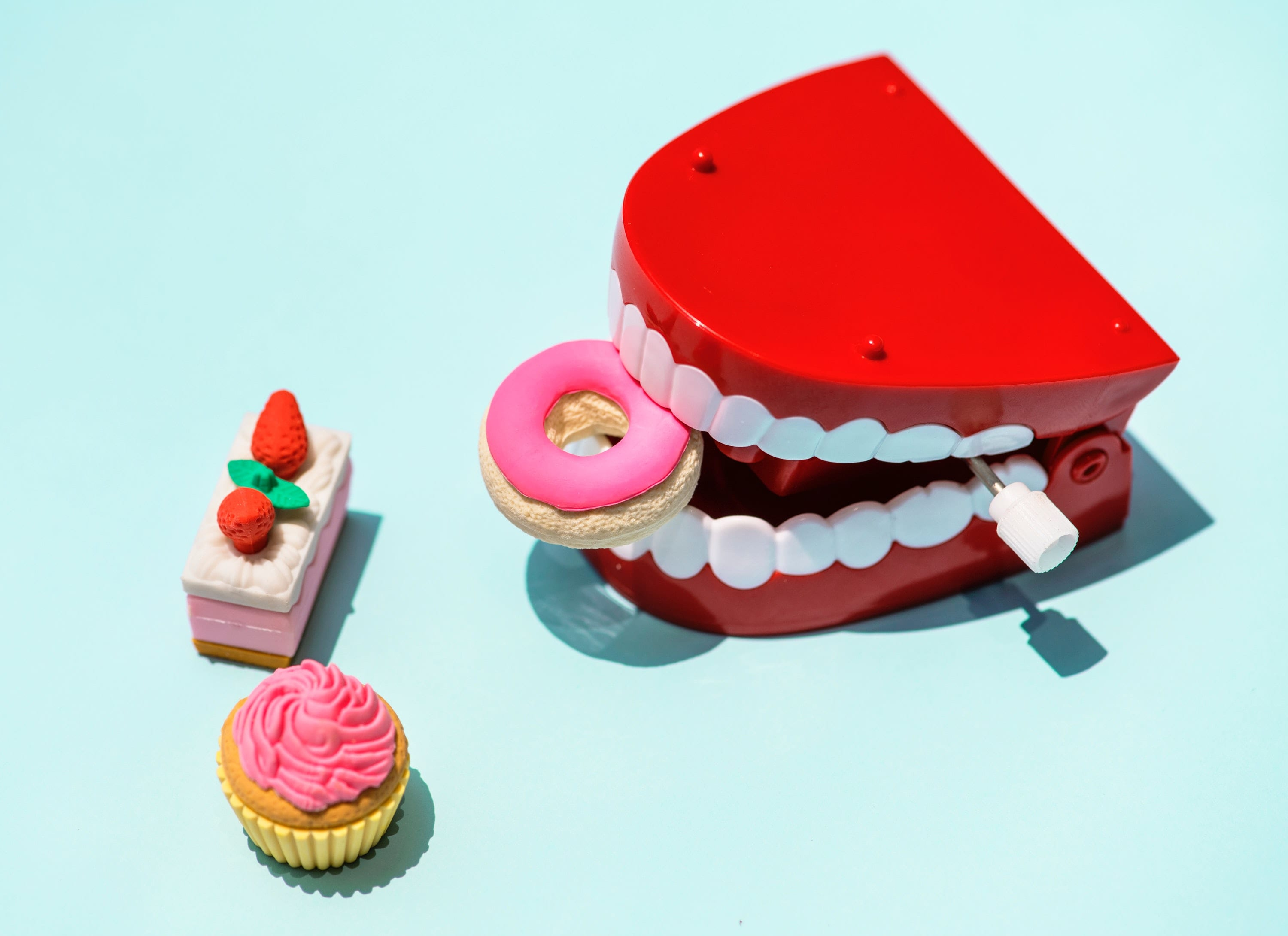 Photo: teeth eating a donut