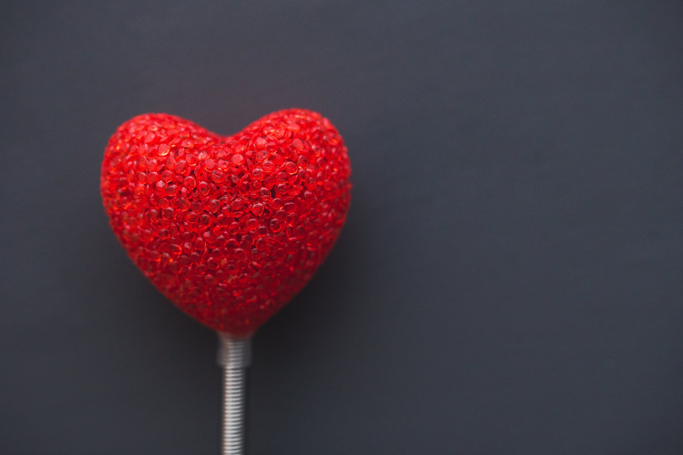 Photo: red heart on a white wand
